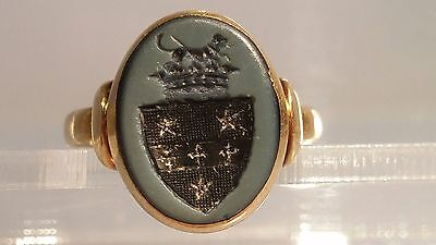 Gold seal ring with heraldic seal dog on a crown above a shield Circa 1850