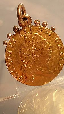 A piece of history 22ct gold half guinea 1802 George III gold coin pendant
