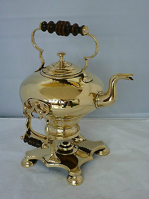 Early Victorian brass bullet kettle on stand with ember heater