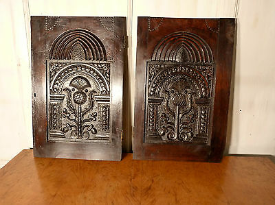 A Pair of Superbly Carved Oak Door Panels