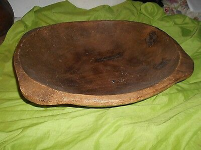 a very large vintage wooden dough bowl