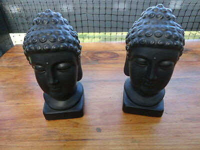 Pair of Matching Ceramic Black Buddha Heads