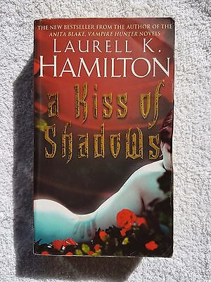 A Kiss of Shadows (Merry Gentry #1) by Laurell K. Hamilton