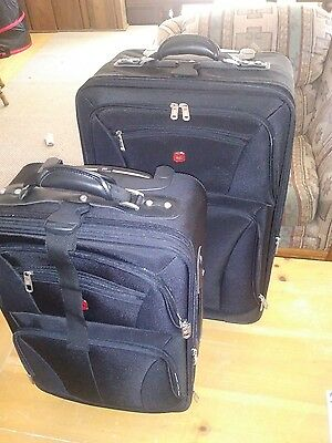 swiss gear carry on luggage 24' and 20' used once set