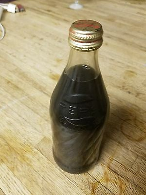 VINTAGE RARE FULL PEPSI COLA BOTTLING ERROR BOTTLE WITH Coca cola Cap16oz.....!