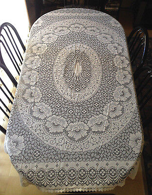 vintage lace tablecloth measuring approx 176 cm x 134 cm.