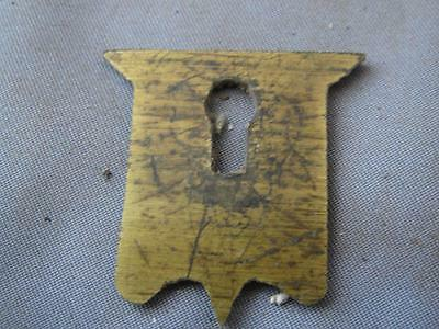 Old solid brass shield escutcheon for a writing box.