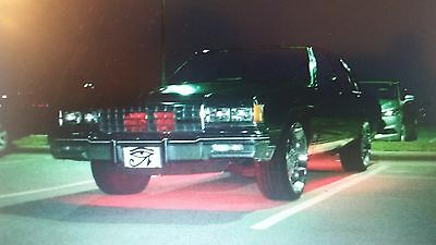 "1985 Chevrolet Caprice Sliver/black 1985 Chevrolet Caprice classic with (God of Horus logo on back) & has 22"" Rims"