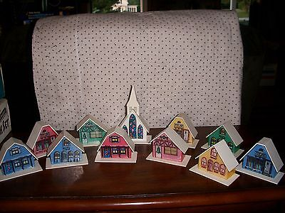 11  Vintage Alpine Village houses & Church.  These can go on a string of lights