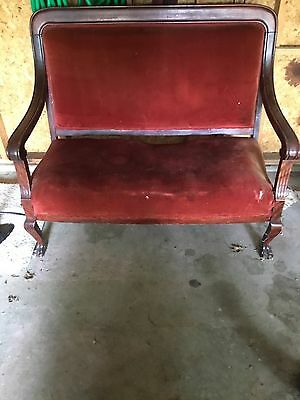 antique loveseat with claw feet