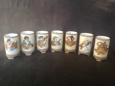 VINTAGE CHINESE CERAMIC 5cm WINE CUPS DEPICTING 7 IMMORTALS SIGNED BASES