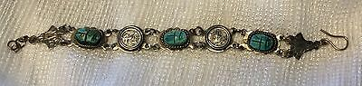 Silver Egyptian Revival carved turquoise color scarab Pharaoh coin bracelet