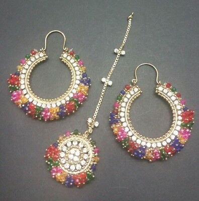 Manjoos (multicolours) Earrings and tikka set in antique gold. Mendi function