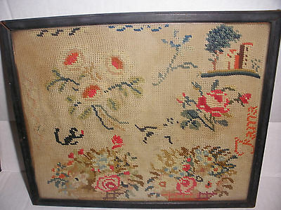 Antique needlepoint sampler with flowers cat and dog  signed