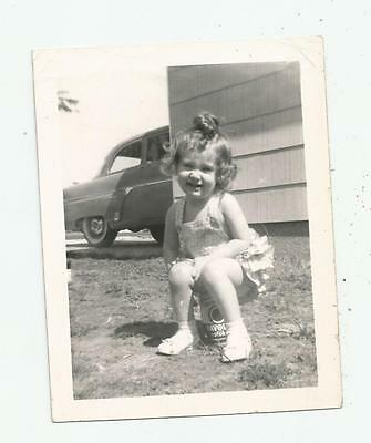 1950's VINTAGE LITTLE GIRL PARKING HER BUTT ON A VALVOLINE OIL CAN CHAIR CUTE!!!
