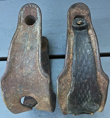 Super nice pair of antique iron saddle stirrups...one with leather still on it.