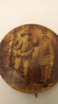 Old   pin with photo of Uncle Remus and Keystone Cop 2 in pin.