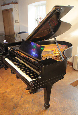 Pre-owned, 1922, Steinway Model O grand piano with a black case.