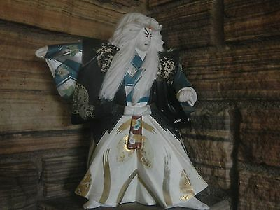 Kabuki doll from the 50's. Some fading on clothes and face, but no chips.