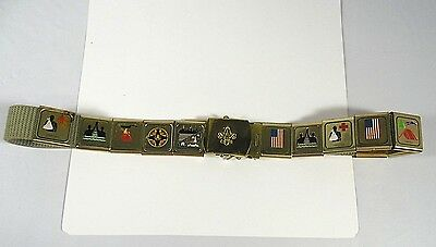 A VINTAGE MID 1970's BOY SCOUTS OF AMERICA BELT WITH 13 MERIT BADGES