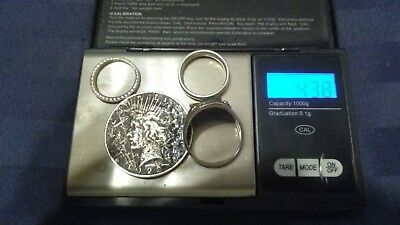 scrap or not silver lot. Peace dollar and 3 Sterling rings 43.8 grams