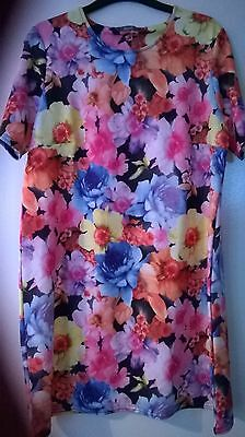 Used Ladies pink flowered dress size 16's