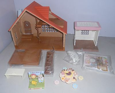 SYLVANIAN FAMILIES,  LOG CABIN BOXED PLUS SWEET STORE (no box) & OTHER ITEMS.