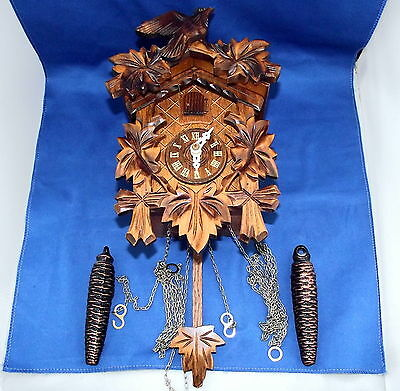 Small Traditional Cuckoo Clock With Weights. Cuckoo And Strike On Gong.