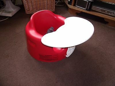 Red Bumbo Seat with tray and straps suitable boy or girl