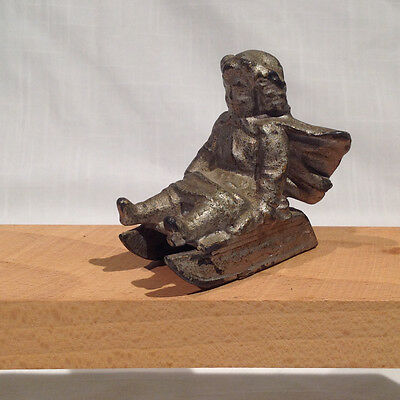 Ca. 1890's LEAD FIGURAL PAPERWEIGHT OR TOY: VICTORIAN GIRL w/ CAPE ON SLED