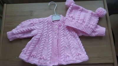 Hand made baby matinee coat and matching hat with pom pom details on either side
