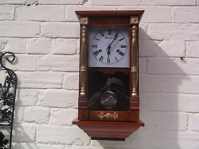 A Wall Clock  Mechanical (Wooden) Gongs The Hour And The Half