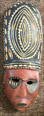 African wooden mask with cut out detail