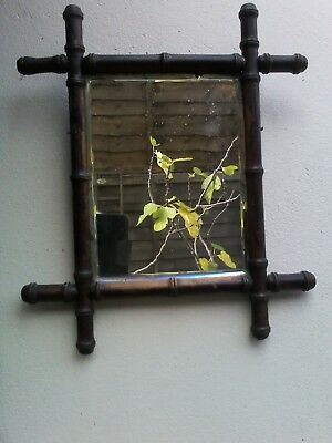 stunning antique faux  bamboo mirror. Aged slightly silvered mirror.
