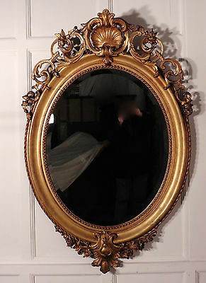 A Very Large French Rococo Oval Gilt Wall Mirror