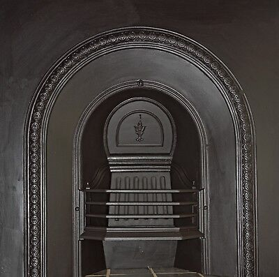 Victorian/Edwardian arched cast iron fireplace