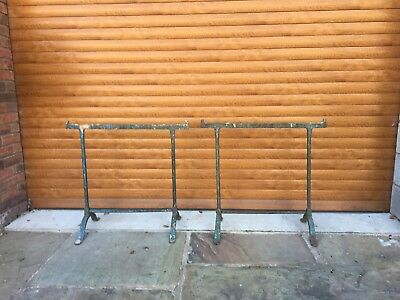A matching pair of antique wrought iron trestles