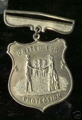 old obsolete UNITED for PROTECTION badge