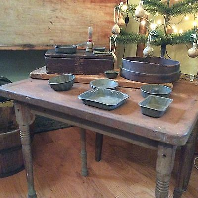 Antique primitive child's table with pots, pans and masher