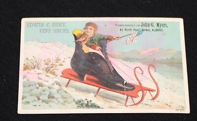 Boy waving American Flag, Sledding in Shoe Sled. Edwin Burt Shoes Adv Card