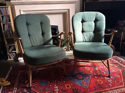 A pair of vintage Ercol Arm Chairs