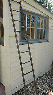 Antique industrial iron factory ladder