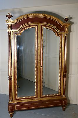 A Glamorous French Art Deco Gold and Burgundy Armoire