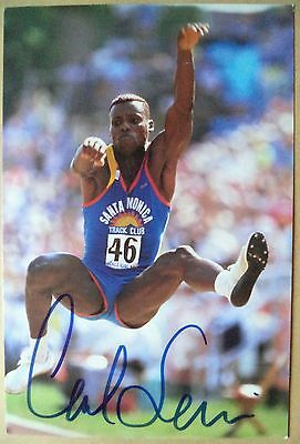 Carl Lewis – 1984, 88, 92 & 96 Olympic Games Long Jump Gold Medals Signed Photo