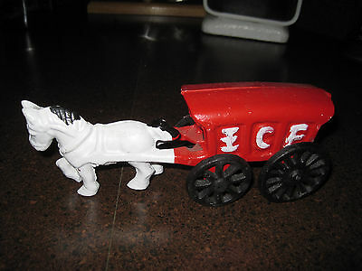Reproduction cast iron horse pulling an ice cart
