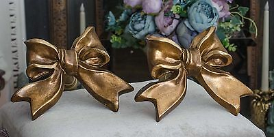 A pair of French very large resin bow statement tie backs