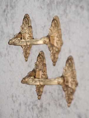 A pair of French antique bronze ornate furniture handles