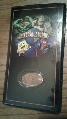 Universal studios pressed penny collector book with a few pennies.