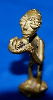 African Gold Weight Man Serving Food