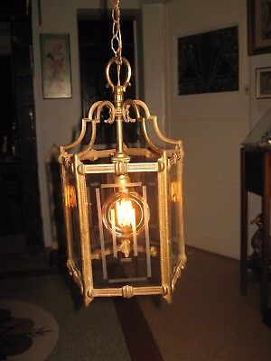 A Vintage Style Brass And Glass Pendant Light